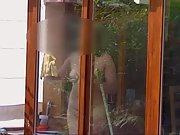 Cleaning the windows naked for the neighbours to observe