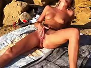 Horny wife with wonderful long legs masturbating rigid at the beach