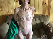 Skinny tattooed grandmother flashing off her pussy
