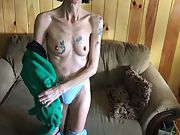 Skinny inked granny stripping and showing her hairy twat